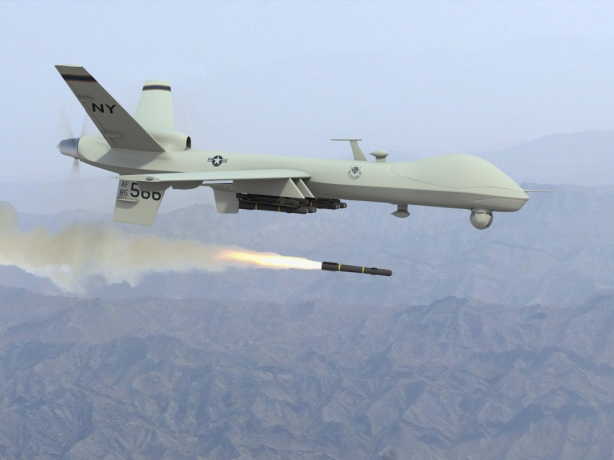An American Predator drone fires a missile.