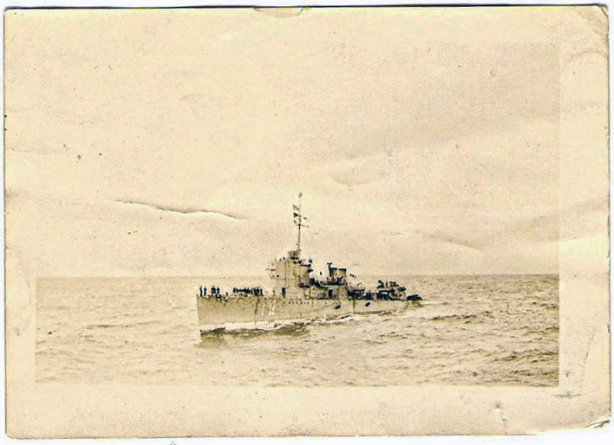 HMS Clare, with my father on board, location unknown but leaving or entering port, I think.