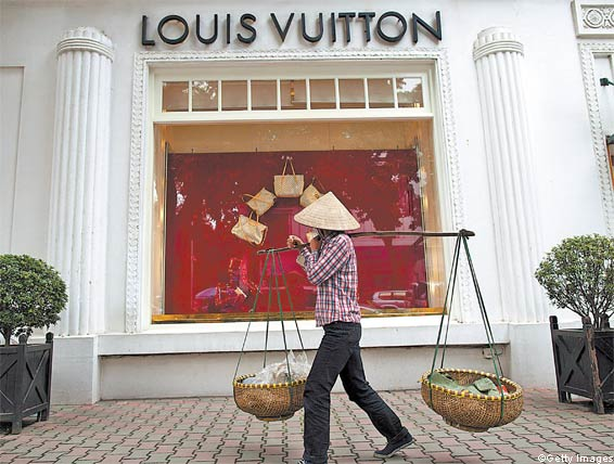 """""""Balancing baskets"""" are still seen everywhere in Vietnam. The effect is somewhat ruined, though, when the woman balacing the baskets comes up and asks """"Happy photograph? Very cheap!"""""""