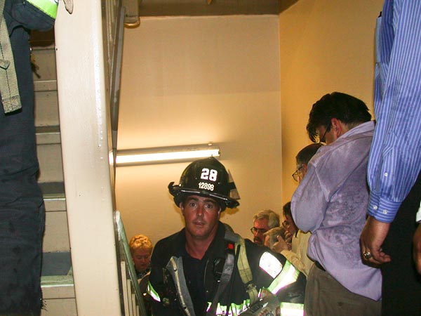 Many able-bodied occupants of the north tower fled down stairwells to safety, some stayed where they were.  Firefighters such as Mike Kehoe (pictured) actually headed up to help the wounded. Kehoe's Ladder 11 firehouse lost six men that day, but he survived to face a life forever changed not only by 9/11 but by the iconic image in which he unwittingly appeared.