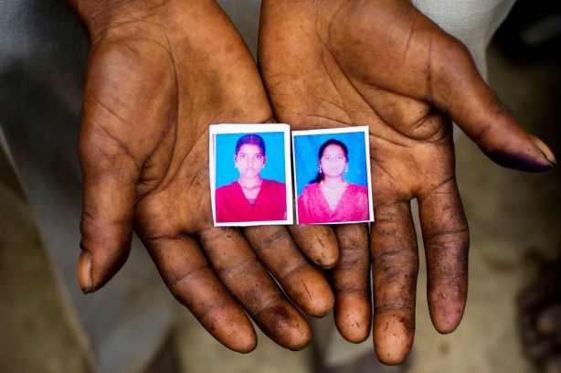 Photographs of the two girls held in the hands of the father of Murti and the uncle of Pushpa (left). They were utterly innocent, and they were people, not a statistic.