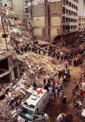 Firefighters and rescue workers search through the rubble of the Buenos Aires Jewish Community centre on July 18, 1994, photo after a car bomb rocked the building.