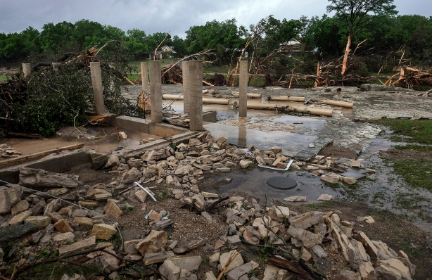The cement stilts of the home belonging to the Carey family of Corpus Christi, Texas, are all that remain the home was swept away by the Blanco River early  Sunday morning during a flash flood in Wimberley, Texas, on Monday, May 25, 2015. The Carey and McComb family, from Corpus Christi, Texas, have been missing since.   (Rodolfo Gonzalez/Austin American-Statesman via AP)