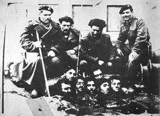 The Greek civil war was recent, and very bloody, Here right wing militia display the heads of their victims.